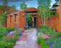 Color and dramatic garden design greet a visitor the residence